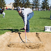 Kaneland Volunteer Will Kripers 16, works a rake at the long jump pit during The Peterson Prep Track Meet<br /> at Kaneland High School in Maple Park, IL on Saturday, April 26, 2014 (Sean King for Shaw Media)