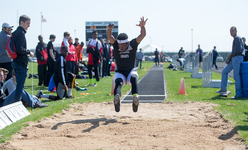 Kaneland Long Jumper Dalvell Triplett executes a jump during The Peterson Prep Track Meet at Kaneland High School in Maple Park, IL on Saturday, April 26, 2014 (Sean King for Shaw Media)