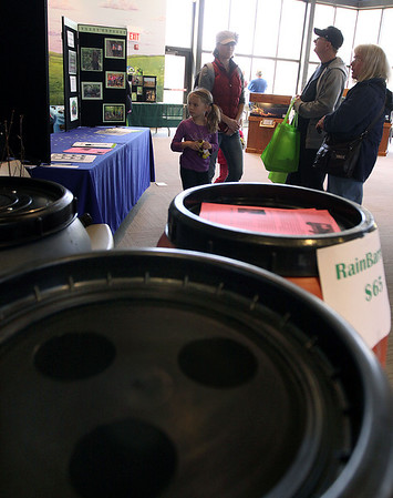 Jeff Krage – For Shaw Media<br /> Rain barrels are a simple, low-cost method to reduce the amount of stormwater runoff from your property. They were for sale Saturday during the St. Charles Green Fest at the Hickory Knolls Discovery Center.<br /> St. Charles 4/26/14
