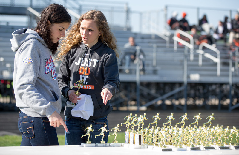 Kaneland Volunteers (Left) Jessica Jucera 16, and Sydney Strang 17, organize awards prior to the start of the Peterson Prep Track Meet at Kaneland High School in Maple Park, IL on Saturday, April 26, 2014 (Sean King for Shaw Media)