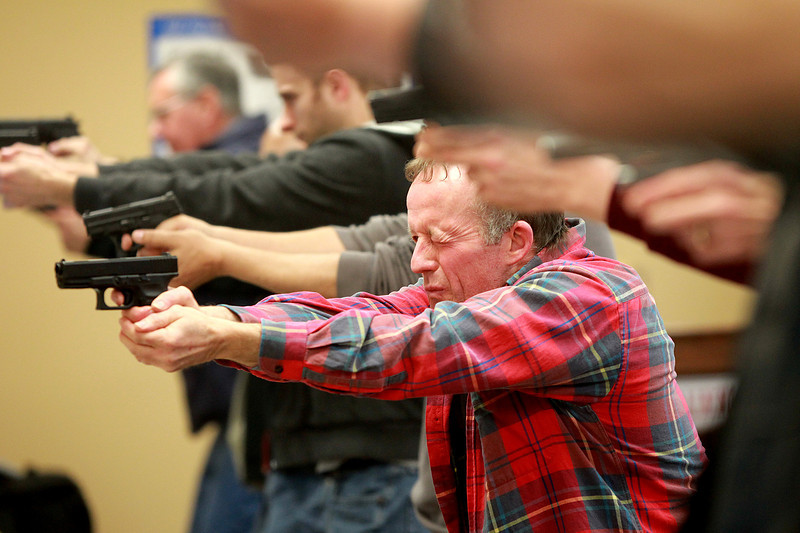 Gary Fernandes of Campton Township learns the proper way to hold his handgun during a conceal and carry class at Gat Guns in West Dundee.