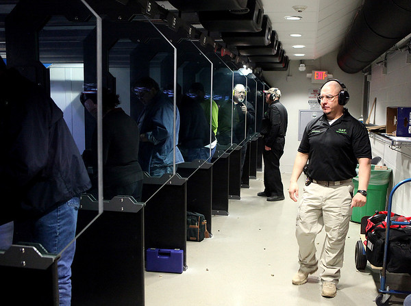Ever Saenz of the Kane County Sheriff Department instructs a conceal and carry class at Gat Guns in West Dundee.