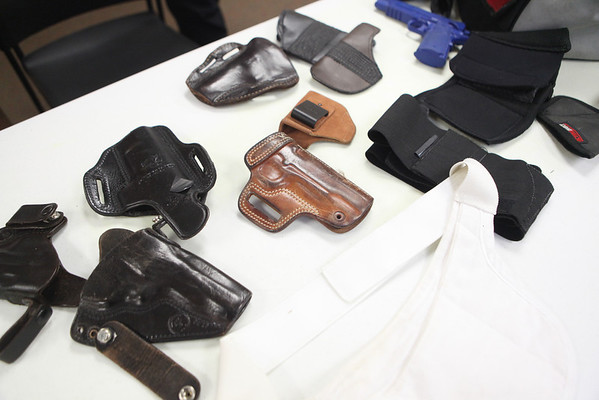 Holsters on display during a conceal carry class at GAT Guns in East Dundee.