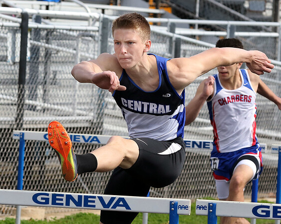 Jeff Krage – For Shaw Media<br /> Burlington Central's Lucas Ege competes in the 110-meter hurdles during the 24th annual Mike VanDeveer Invitational at Geneva High School on Saturday.<br /> Geneva 4/18/15