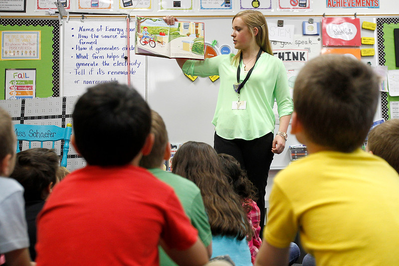 """Matthew Apgar - mapgar@shawmedia.com Husmann Elementary School teacher Emily Schaefer reads from the book """"Newton And Me"""" during STEM (Science Technology Engineering Mathematics) class on Monday, April 20, 2015 at Husmann Elementary in Crystal Lake. The students were learning about forces needed to push and pull objects."""