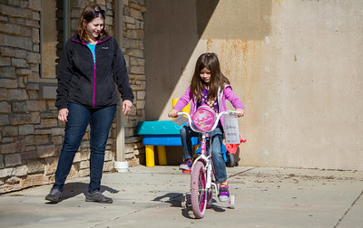 Mike Greene - For Shaw Media Elizabeth Nemerow, of Lake in the Hills, watches as her daughter Sophia, 5, test out a bike during the Second Annual Wheels and Deals Sale Saturday, April 16, 2016 at Village Hall in Lake In The Hills. The program allows sellers to determine the selling price, with the city co-oping the sale, and sellers receive 80% of the price on items sold.