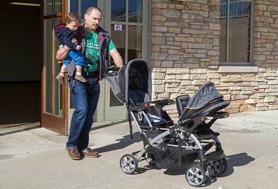 Mike Greene - For Shaw Media Jose Rios, of Crystal Lake, walks with his son Emmanuel, 1, after purchasing a stroller during the Second Annual Wheels and Deals Sale Saturday, April 16, 2016 at Village Hall in Lake In The Hills. The program allows sellers to determine the selling price, with the city co-oping the sale, and sellers receive 80% of the price on items sold.