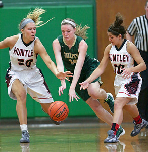 Crystal Lake South's Chanel Fanter (14) drives between Huntley's Ali Andrews (left) and Hannah Warren (10) during the second half of the McHenry County All Area Girl's All-Star Basketball Extravaganza at Alden-Hebron High School on Sunday, April 17, 2016 in Hebron, Illinois. The away team won the game 87-51.  John Konstantaras photo for the Northwest Herald
