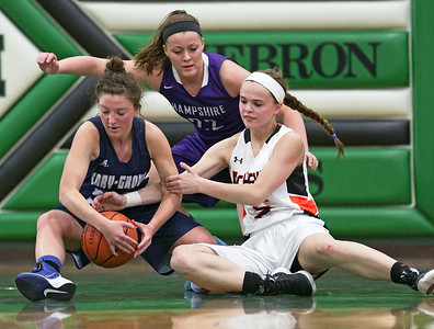 Cary-Grove's Jen Pilut (left) grabs the ball from McHenry's Kaleigh Johnson (right) as Hampshire's Emma Benoit (22) watches during the second half of the McHenry County All Area Girl's All-Star Basketball Extravaganza at Alden-Hebron High School on Sunday, April 17, 2016 in Hebron, Illinois. The away team won the game 87-51.  John Konstantaras photo for the Northwest Herald