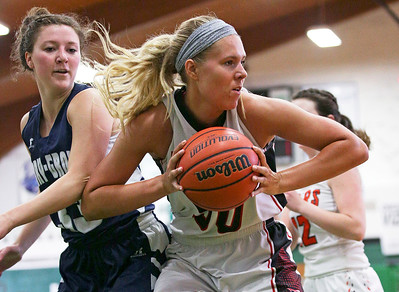 Huntley's Ali Andrews (50) grabs a rebound in front of Cary-Grove's Jen Pilut during the second half of the McHenry County All Area Girl's All-Star Basketball Extravaganza at Alden-Hebron High School on Sunday, April 17, 2016 in Hebron, Illinois. The away team won the game 87-51.  John Konstantaras photo for the Northwest Herald