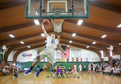 Johnsburg's Joe Bein (21) goes up for a dunk during the finals of the slam dunk contest before the McHenry County All Area Boy's All-Star Basketball Extravaganza at Alden-Hebron High School on Sunday, April 17, 2016 in Hebron, Illinois.  John Konstantaras photo for the Northwest Herald