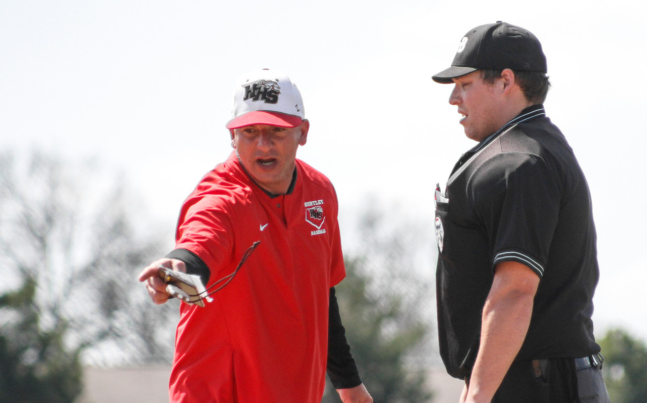 Mike Greene - For Shaw Media  Huntley head coach Andy Jakubowski argues a call with the umpire during a baseball game against Jacobs Saturday, April 23, 2016 in Huntley. Huntley defeated Jacobs 6-5 in nine innings.