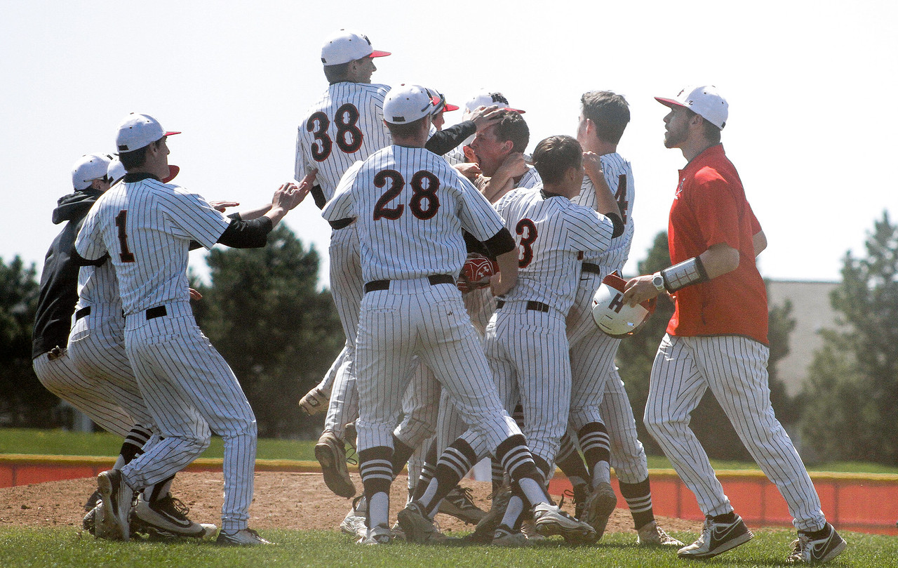 Mike Greene - For Shaw Media  Huntley players celebrate after defeating Jacobs 6-5 in nine innings of a baseball game against Huntley Jacobs Saturday, April 23, 2016 in Huntley.