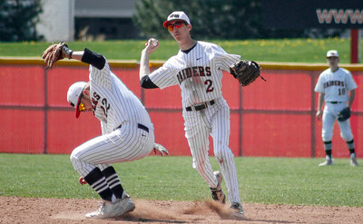 Mike Greene - For Shaw Media  Huntley's Charlie Nugent, right, prepares to throw to first base as teammate Trevor Ranallo moves out of the way during a baseball game against Jacobs Saturday, April 23, 2016 in Huntley. Huntley defeated Jacobs 6-5 in nine innings.