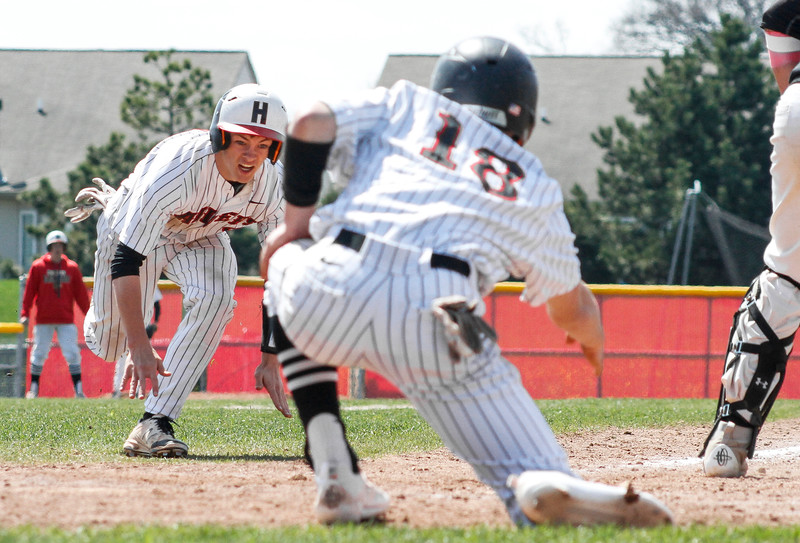 Mike Greene - For Shaw Media  Huntley's Joe Boland, left, prepares to slide into home plate as teammate Tyler Koss directs his slide during a baseball game against Jacobs Saturday, April 23, 2016 in Huntley. Huntley defeated Jacobs 6-5 in nine innings.