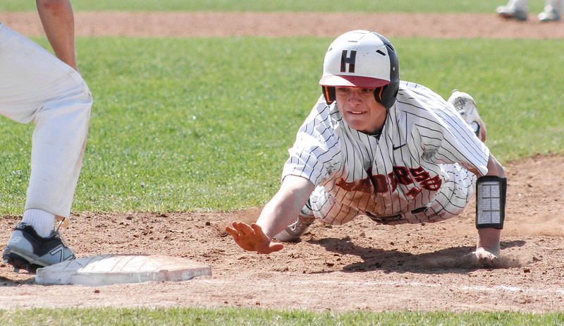 Mike Greene - For Shaw Media  Huntley's Tyler Koss dives back to first base during a baseball game against Jacobs Saturday, April 23, 2016 in Huntley. Huntley defeated Jacobs 6-5 in nine innings.