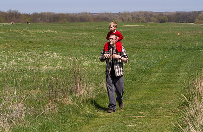 Mike Greene - For Shaw Media Cory Moore, of Crystal Lake, walks through the prairie with son Jackson, 3, during Earth Day Celebration 2016 Saturday, April 23, 2016 at Prairieview Education Center in Crystal Lake. The event included guided nature hikes, games and crafts, puppet Shows, over 20 environmental exhibitors, as well as food & beverage vendors.