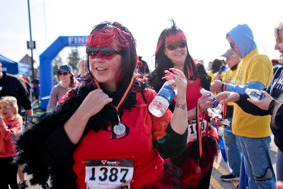 Michelle LaVigne/ For Shaw Media Running for Horizons for the Blind, Dawn Jurkiewicz of Johnsburg and Lisa Dahlke of Lakewood, grab some water as they finish out the McHenry County Human Race held at McHenry County College on Sunday April 24, 2016.