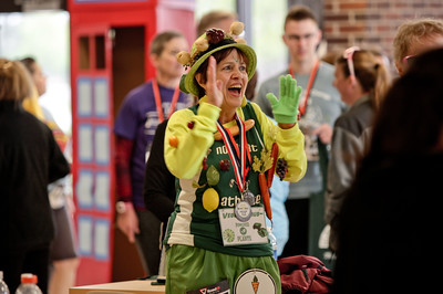 "Michelle LaVigne/ For Shaw Media ""Vegan Venus,"" also known as Joan Davin, cheers on her friends during the awards ceremony at the McHenry County Human Race held at McHenry County College on Sunday April 24, 2016. Davin ran the race to promote a plant-based eating lifestyle."