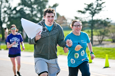 Michelle LaVigne/ For Shaw Media Griffon Carroll of McHenry joins Taylor Clemons of McHenry to help her finish out the McHenry County Human Race held at McHenry County College on Sunday April 24, 2016.