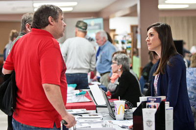 Michelle LaVigne/ For Shaw Media Veterans Service Officer Sonia Castaneda listens to Marine veteran Ronald Cuthbertson of Marengo as he stops by her booth during the Veteran Stand Down Resource Fair held at the McHenry VFW on Thursday, April 28 2016. The event was hosted by the McHenry County Veterans Assistance Commission.