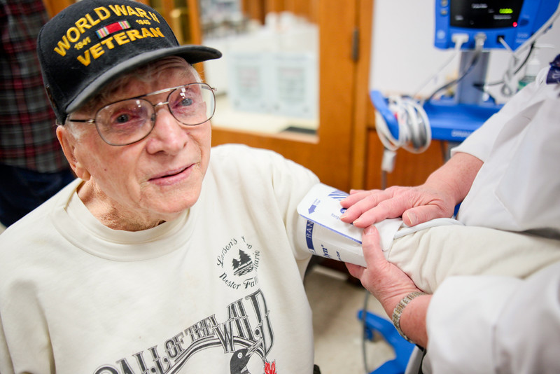"Michelle LaVigne/ For Shaw Media WWII and Korean war veteran Howard Lexow of McHenry receives a free blood pressure screening from LPN Missy Robel of Ringwood while attending the Veteran Stand Down Resource Fair held at the McHenry VFW on Thursday, April 28 2016. Robel said she valued working with veterans like Lexow. ""It's not a job, it's an honor."""