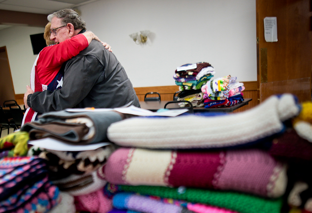 Michelle LaVigne/ For Shaw Media Charlotte Kennedy, president and founder of St. P's Lapghans for Veterans, gives a hug to Army veteran Bill Warn of McHenry after he picked out a lapghan for his wife during the Veteran Stand Down Resource Fair held at the McHenry VFW on Thursday, April 28 2016. In 22 months, 829 lapghans have been distributed through the St. P's nonprofit to veterans.