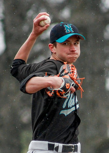 Mike Greene - For Shaw Media  Woodstock North's Jake Busse pitches in the rain during a baseball game against Woodstock Saturday, April 30, 2016 at Emricson Park in Woodstock. Woodstock North defeated Woodstock 15-7.