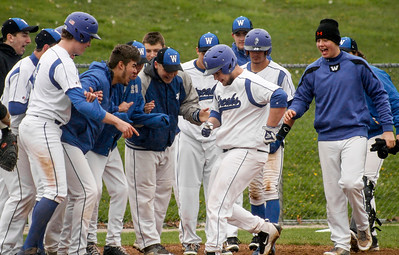 Mike Greene - For Shaw Media  Woodstock's Daniel Mutter crosses home plate surrounded by teammates after hitting a two-run home run during a baseball game against Woodstock North Saturday, April 30, 2016 at Emricson Park in Woodstock. Woodstock North defeated Woodstock 15-7.
