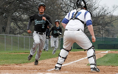 Mike Greene - For Shaw Media  Woodstock North's Jesse Cordoba, left,  prepares to touch home plate as teammate Nate Harris follows close behind during a baseball game against Woodstock Saturday, April 30, 2016 at Emricson Park in Woodstock. Woodstock North defeated Woodstock 15-7.