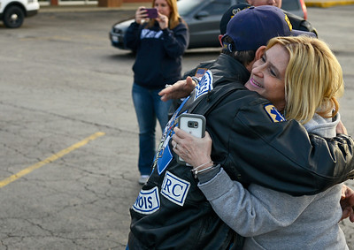 Kayla Wolf - For Shaw Media Carla Coulter hugs Steve Mosias (cq) the President of EMS Roaddocs of Illinois Saturday April 1, 2017. Coulter is the mother of Sam Bronowski, not pictured, who arrived home to Marengo after two years of duty in the armed forces.