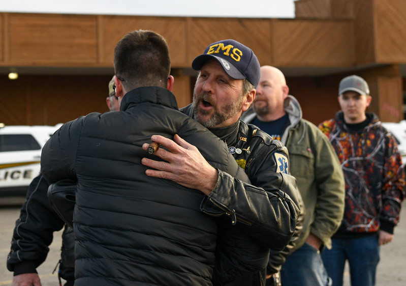 Kayla Wolf - For Shaw Media Sam Bronowski hugs Steve Mosias (cq) the President of EMS Roaddocs of Illinois prior to escorting Bronowski and his mother through downtown Marengo on Saturday April 1, 2017. Bronowski was welcomed home after two years on duty.