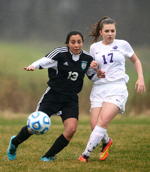Woodstock North sophomore Mariana Vergara, left, gains control of the ball as Hampshire freshman Sarah Gaudaen (cq) goes for a tackle Monday April 3, 2017, during a game at Hampshire High School. Woodstock North won 3-2.