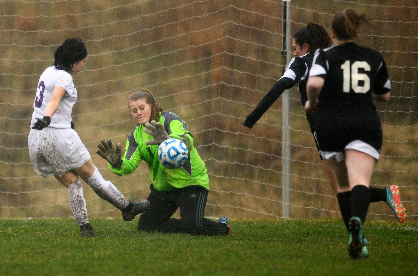 Hampshire freshman Alessa Carranza (cq) shoots the ball as Woodstock North goalkeeper Kylie Finch misses the save Monday April 3, 2017 at Hampshire High School. Woodstock North won 3-2.