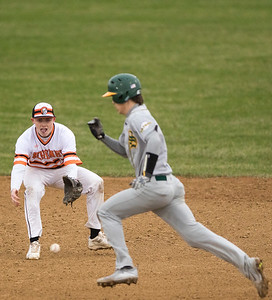 Sarah Nader - snader@shawmedia.com McHenry's Nick Finley (left) eyes a ground ball while  Crystal Lake South's Kory Olsen runs to second during Tuesday's game in McHenry April 4, 2017.