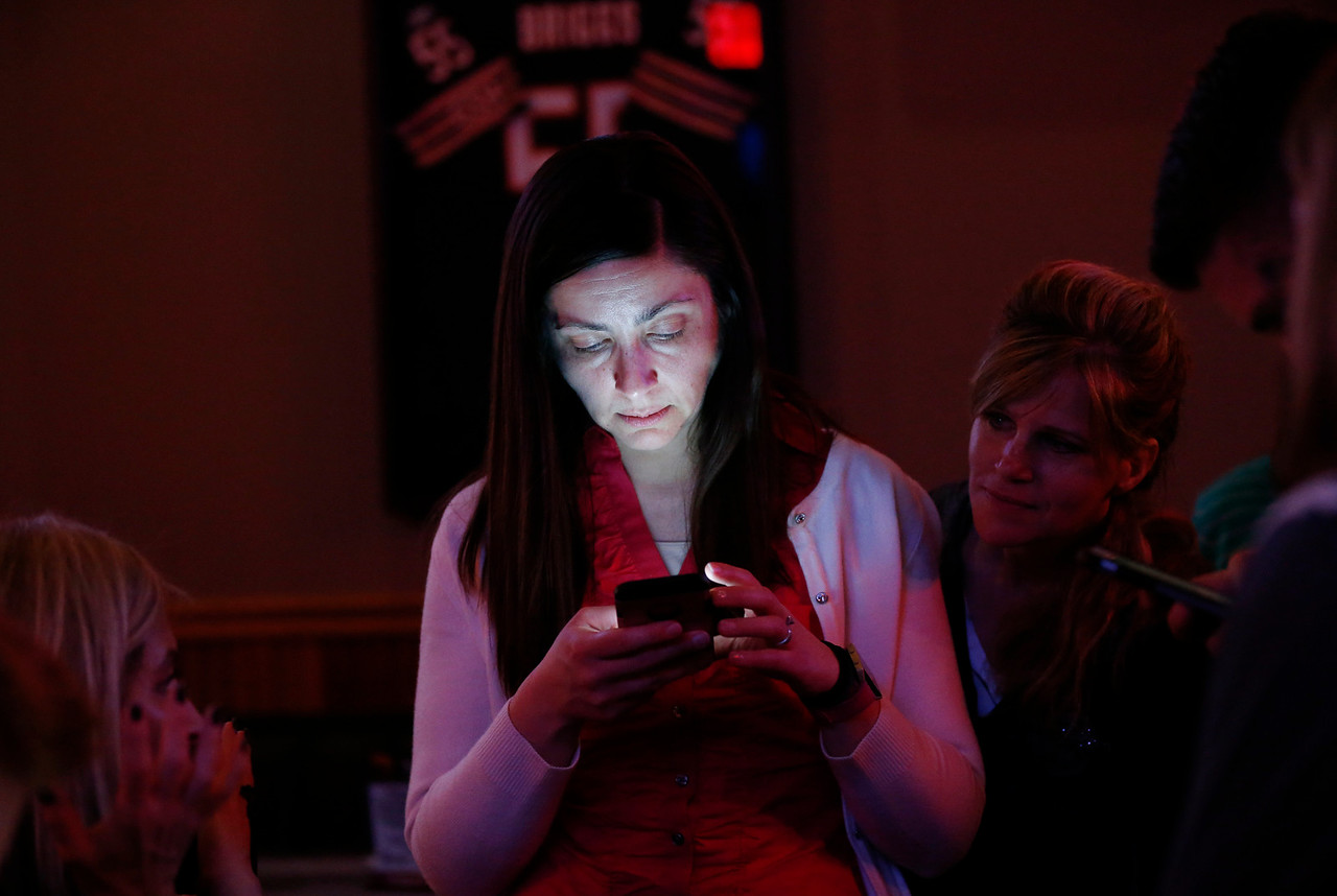 Cary Trustee Kim Covelli tracks election results for Jim Cosler her phone at Tracks Bar and Grill on Tuesday, April 4, 2017 in Cary. Cosler was in a close race for Cary Mayor with Mark Kownick. John Konstantaras photo for the Northwest Herald