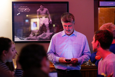 Cary Trustee Jim Cosler checks his phone as he waits for results for his mayoral race at Tracks Bar and Grill on Tuesday, April 4, 2017 in Cary. Cosler was in a close race with Mark Kownick. John Konstantaras photo for the Northwest Herald