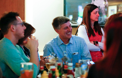 Cary Trustee Jim Cosler, center, waits for results for his mayoral race with supporters at Tracks Bar and Grill on Tuesday, April 4, 2017 in Cary. Cosler was in a close race with Mark Kownick. John Konstantaras photo for the Northwest Herald