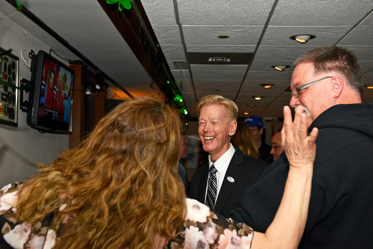 Kayla Wolf - For Shaw Media Magdalena Rivera celebrates the updated results of Woodstock's mayoral election with Brian Sager, center, Tuesday, April 4, 2017, at the VFW. Many of Sager's friends and campaigners joined him at the VFW.