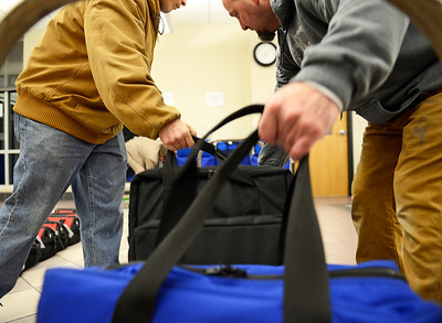 Kayla Wolf - For Shaw Media Brian Kline, left, and Kelly Roach unload and sort election materials at the McHenry County Administration Building Tuesday, April 4, 2017. The votes were counted by uploading the secure memory cards from each machine directly into a database, the votes were not transmitted over any networks to ensure accuracy and safety.