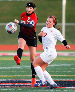 Sarah Nader - snader@shawmedia.com Huntley's Tayah Owens (left) is guarded by Marian Central's Lucca Kenyon while she kicked the ball down field during the first half of Thursday's match at Huntley High School April 6, 2017.