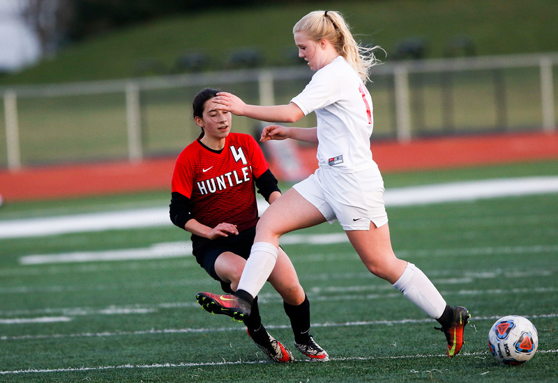 Sarah Nader - snader@shawmedia.com Marian Central's Addison Fortin (right) tries to steal the ball from Huntley's Alyssa Xanos during the first half of Thursday's match at Huntley High School April 6, 2017.