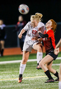 Sarah Nader - snader@shawmedia.com Marian Central's Addison Fortin and Huntley's Braidy Ceh head the ball during the second half of Thursday's match at Huntley High School April 6, 2017.