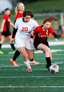 Sarah Nader - snader@shawmedia.com Marian Central's Lina Wolf (left) runs after Huntley's Braidy Ceh while she dribbles towards the goal during the first half of Thursday's match at Huntley High School April 6, 2017.