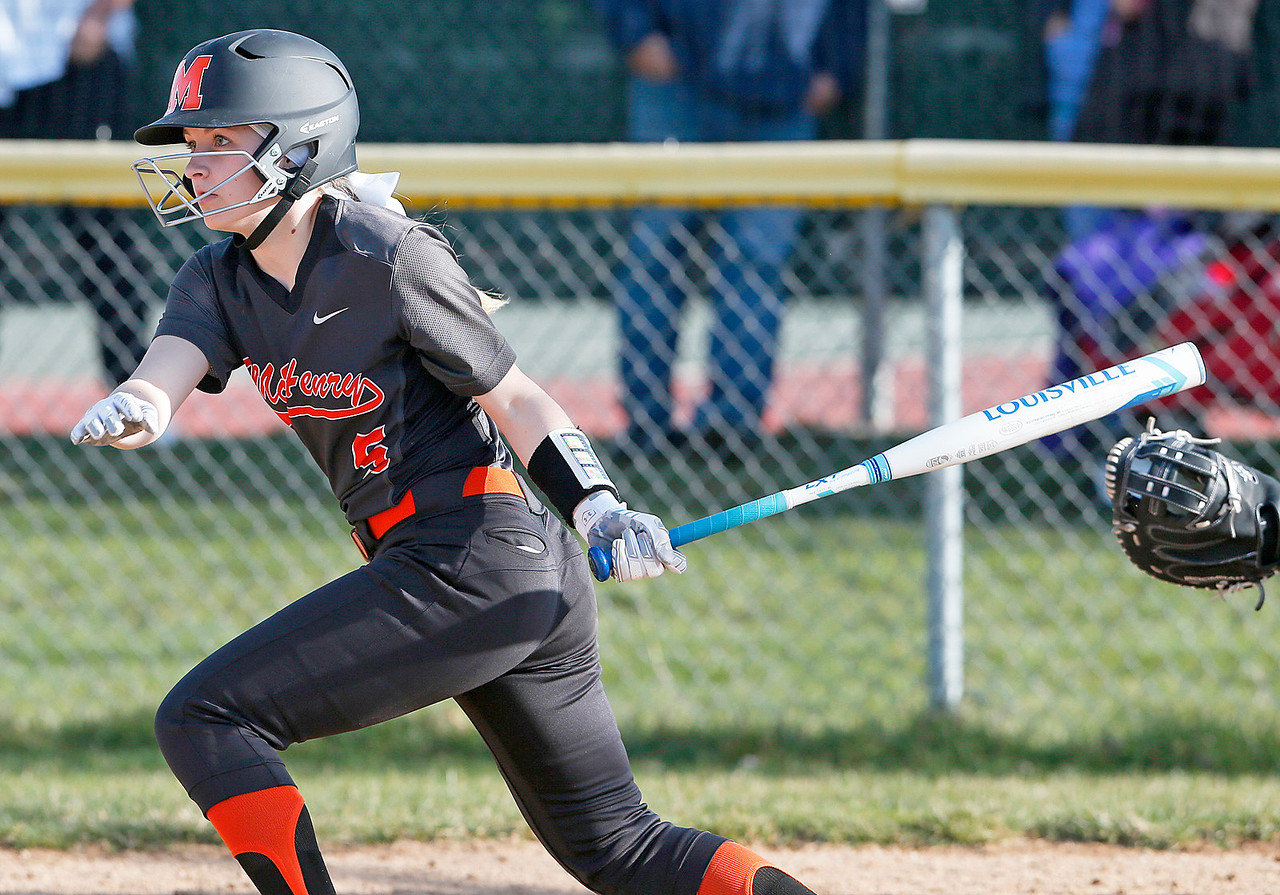 Jocelyn Currie (5) from McHenry hits a 3 RBI double during the fourth inning of their game against Wauconda at Wauconda High School on Friday, April 7, 2017 in Wauconda. The Warriors defeated the Bulldogs 7-6. John Konstantaras photo for the Northwest Herald