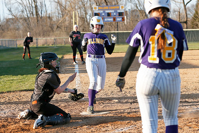 Sydney Rodgers (6) from Wauconda scores on a three run double by Kelly Weller (15) during the seventh inning of their game at Wauconda High School on Friday, April 7, 2017 in Wauconda. The Warriors defeated the Bulldogs 7-6. John Konstantaras photo for the Northwest Herald