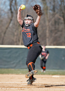 Lindsey Ciesla (12) from McHenry delivers a pitch during the first inning of their game against Wauconda at Wauconda High School on Friday, April 7, 2017 in Wauconda. The Warriors defeated the Bulldogs 7-6. John Konstantaras photo for the Northwest Herald