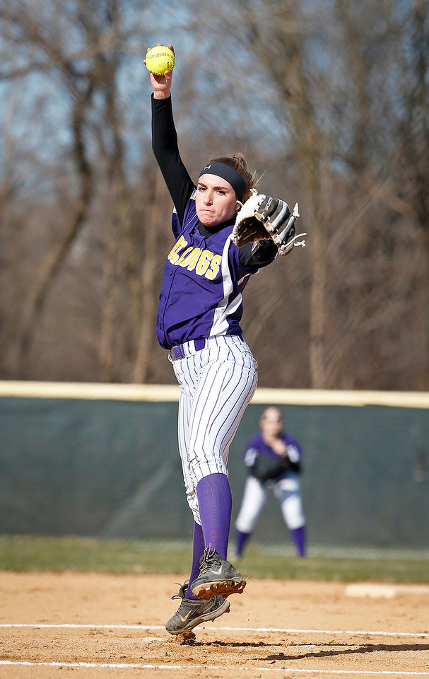 Kelly Weller (15) from Wauconda delivers a pitch during the first inning of their game against McHenry at Wauconda High School on Friday, April 7, 2017 in Wauconda. The Warriors defeated the Bulldogs 7-6. John Konstantaras photo for the Northwest Herald