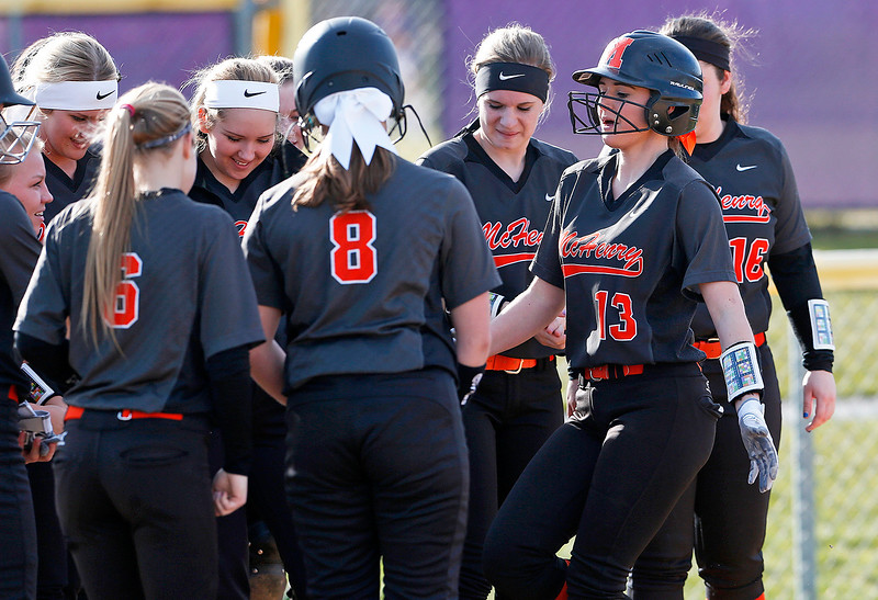 Tori Boysen (13) from McHenry is greeted at the plate after hitting a home run during the third inning of their game against Wauconda at Wauconda High School on Friday, April 7, 2017 in Wauconda. The Warriors defeated the Bulldogs 7-6. John Konstantaras photo for the Northwest Herald