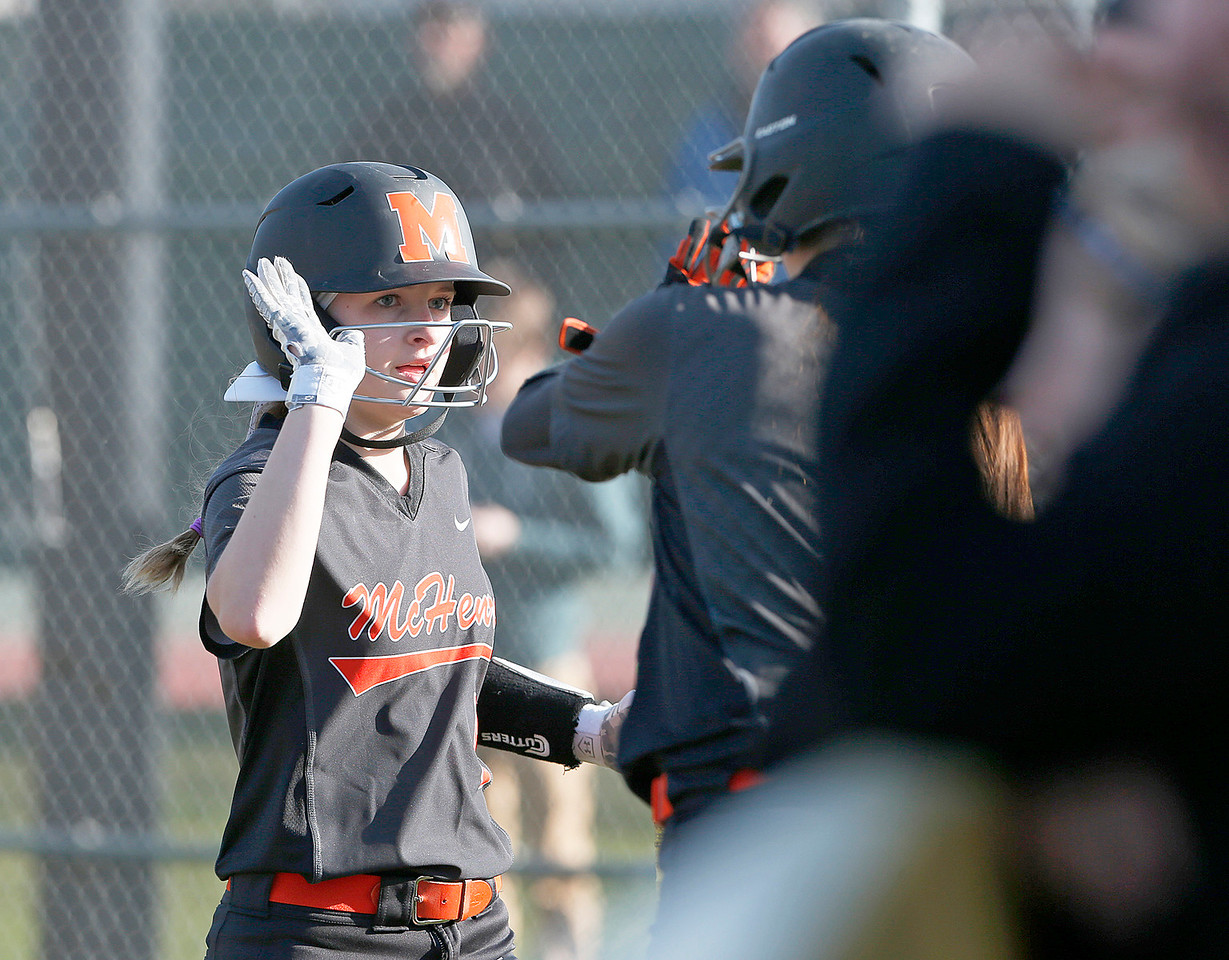 Jocelyn Currie (5) from McHenry heads to the bench after scoring on a double by Mannon Amelio (not pictured) during the fourth inning of their game against Wauconda at Wauconda High School on Friday, April 7, 2017 in Wauconda. The Warriors defeated the Bulldogs 7-6. John Konstantaras photo for the Northwest Herald